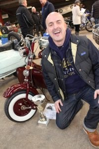 One of the happy, smiling trophy winners from the previous Scooter World
